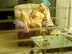 window voyeur-girl masturbates