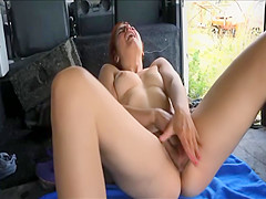 Redhead applies lotion and plays