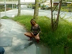 cute young girl peeing in public