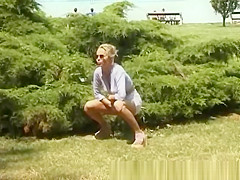 blonde peeing on the beach