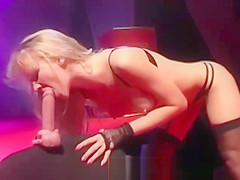 Blond strips and teases the crowd with her body and dildo