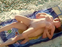 Spying guy catches a couple copulating at the beach