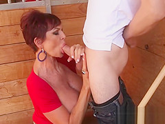 Busty Mature Gets a Hard Penis