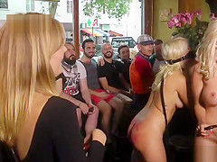 Busty blondes disgraced in crowded bar