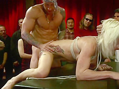 Busty blonde gangbang fucked at public party