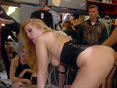 Blonde spanked and caned in public