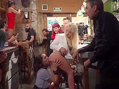 Brunette made to rimjob in public bar