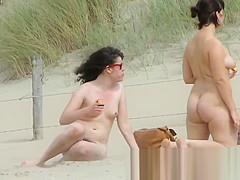 Chick on a nudist beach tanning and bending a nudist beach v