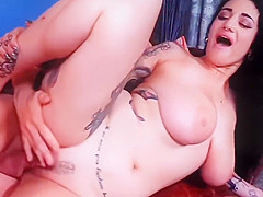 busty brunette tattoo girl gets dick in pussy