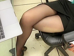 Office lady legs in black pantyhose and heels