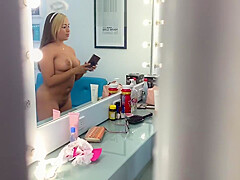 Samanta is spied by her friend while doing her make up naked