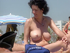 Incredible big boobs nudist milf on the beach