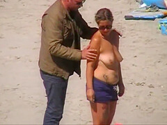 German milf on french beach spy. Shaky quality.