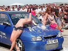 Busty babes put on sexy carwash show for an audience