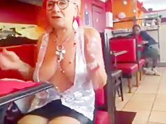 Old woman showing off her big chest