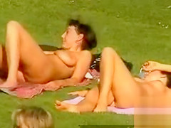 Naked ladies all tanning in the park