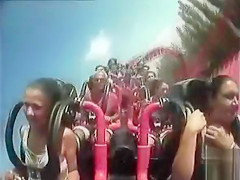 Big tits pop out on the rollercoaster