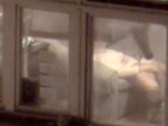 Lovely babe filmed masturbating through apartment window