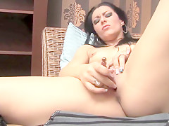 Slutty Sonya Finger Fucks Her Pussy On The Couch