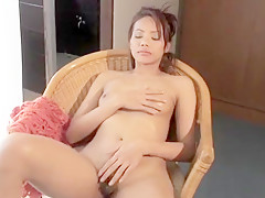 Hot babe Patra sits on a chair rubbing her nipples and fucking herself