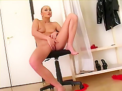 Sexy blonde with lovely tits Valerie Hilton fingers her twat to orgasm
