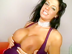 MILF with stunning dark skin and huge fake jugs rides Chris Strokes