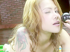 Inked babe Kate has some fun being naughty and playing pool topless