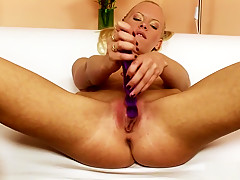 Elegant blonde loses her white panties and has fun with a purple toy