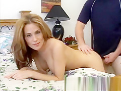 Luscious redhead milf with big tits Ginger Lee gets nailed doggy style