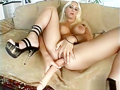 Attractive blonde with big tits has fun with a dildo before enjoying a hard cock