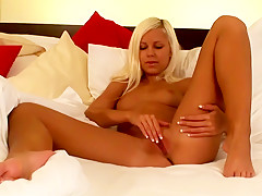 Stunning young blonde nympho spreads her gorgeous pussy lips