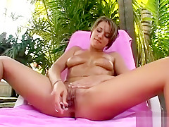 Gorgeous young brunette with lovely tits Ava pleases herself outside