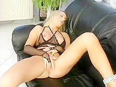 A sultry blonde beauty in sexy fishnets makes herself cum hard