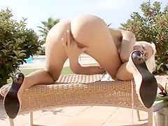 With the sun kissing her fabulous body, Lola caresses her sweet pussy