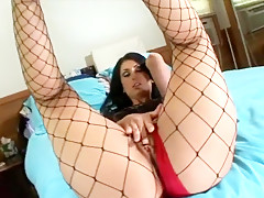 Black haired skank in fishnets teases you with her fine ass and feet