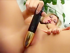 Striking blonde beauty Katja rides the sybian and reaches her climax