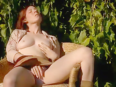 A milf with red hair masturbating outdoors.