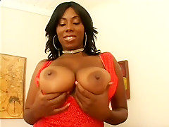 Good-looking ebony chick with huge boobs is getting her pussy banged