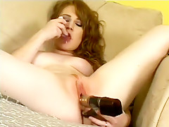 Striking young babe with small tits Lucy Fire pleases her twat with two sex toys