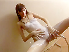 Innocent young babe Capri rubs lotion on her body in teasing solo clip