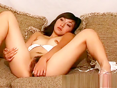 Yume poses her sexy body on the couch and trades head with a dude