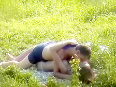Enthusiasts having sex about the lawn gets secretely record