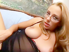 Nerdy blonde with big tits plays with a sex toy and enjoys a hard cock