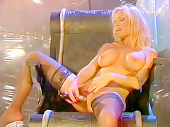 Dick hardening hot blonde sits in her chair toying her cunt away