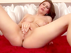 Busty brunette Arwyn shows off her hot stuff and fingers her clit
