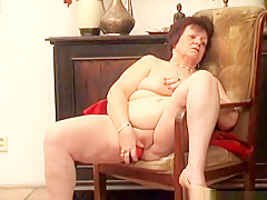 Horny grandma Jindri massages her big boobs and drills her juicy twat