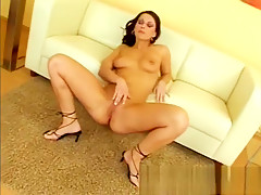 Voluptuous goddess spreads her sexy legs and drills her aching pussy