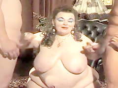 Bbw mature lady gets dildoed and fisted by two guys.