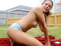 Camgirl with toys in garden