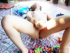 Beautiful Ying Charintip finds herself alone outside and fucks a dildo